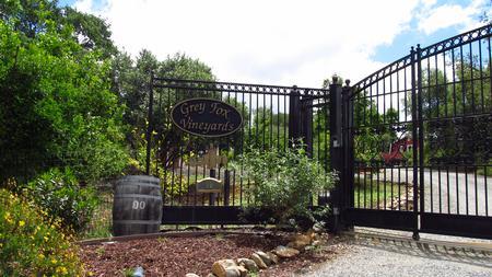 Enter the gates to our vineyard estate.
